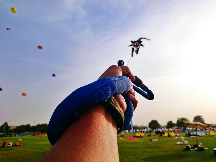 Sky People One Person Competition Kite Flying Kites Outdoors Kite Festival Eyeem Philippines Hand Hold Body Part