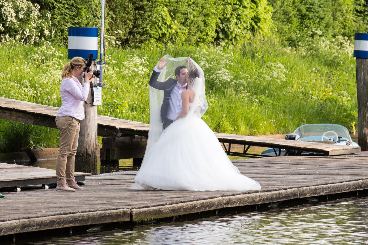 wedding, bride, wedding dress, bridegroom, married, wife, females, young women, love, women, life events, young adult, togetherness, happiness, celebration, dedication, bonding, men, veil, outdoors, real people, day, full length, adult, people, adults only