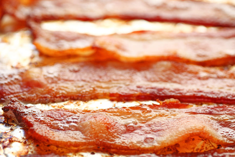 Oven-fried bacon on foil-lined pan Breakfast Fatty Food Hot Natural Light Pork Textures Bacon Bubbling Close-up Day Food Food Preparation Freshness Greasy Home Cooking Indoors  Low-carb No People Oven-fried Ready-to-eat Sizzling Slices Unhealthy Eating