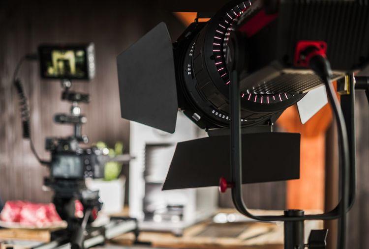 Close-up of camera with spot light at studio