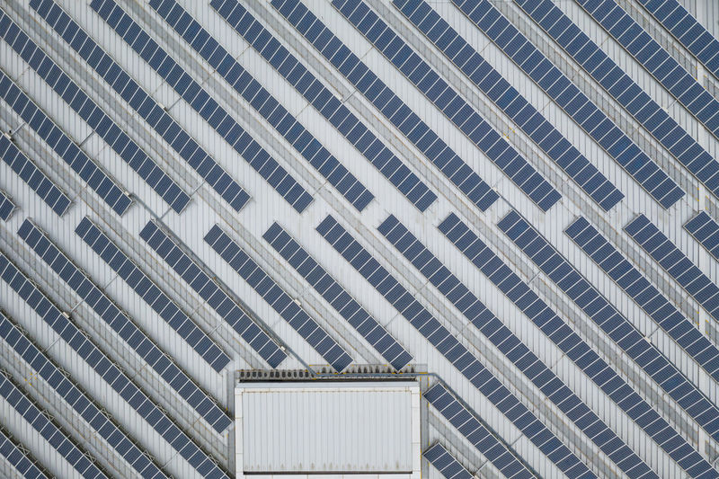 Solar panel Built Structure Architecture Pattern Building Exterior Low Angle View No People Full Frame Building Backgrounds Day Architectural Feature Ceiling Wall - Building Feature Design Modern Roof Shape Outdoors Geometric Shape Architecture And Art