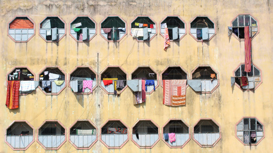 In A Row Side By Side No People Day Building Exterior Architecture Built Structure Wall - Building Feature Multi Colored Hanging Order Building Window Repetition Arrangement Variation