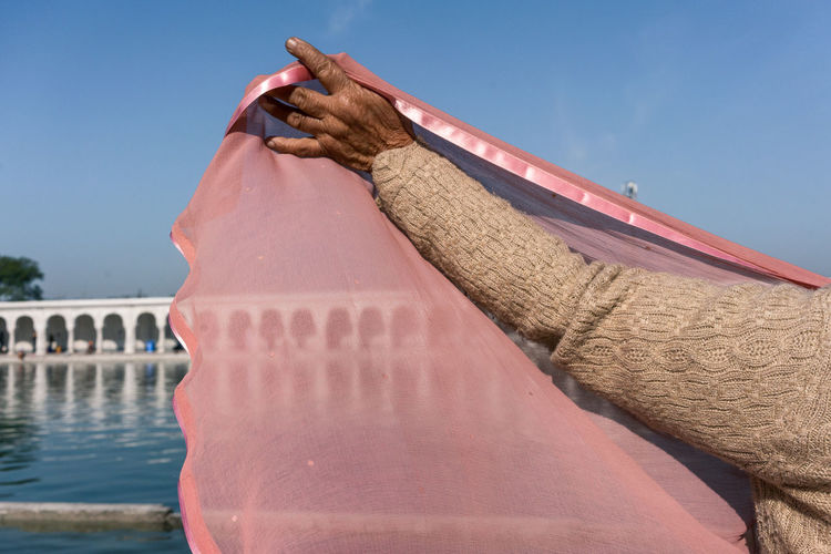 Veiled Anandpur Sahib Anandpur Sahib Gurudwara Cultures Day Everyday Lives India One Person Outdoors Pink Pink Color Punjab Real Life Real People Real People, Real Lives Sky Street Photography Streetphotography Travel Travel Destinations Travel Photography