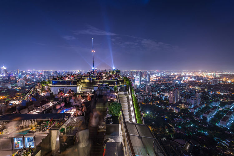 Nice view on the top of the building in the middle of Travel Nikon EyeEmNewHere Bangkok Tower Dinner City Architecture Building Exterior Night Illuminated Built Structure Cityscape High Angle View Transportation Sky Building Crowd Crowded City Life Motion Mode Of Transportation Street Road Travel Destinations Outdoors Modern Office Building Exterior Skyscraper