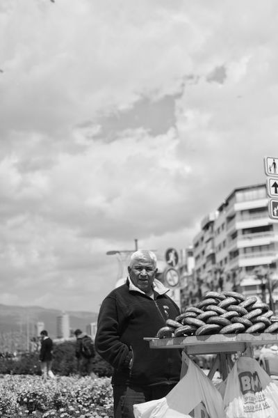 The Street Photographer - 2017 EyeEm Awards Fujifilm_xseries Acros100 Blackandwhite Capture The Moment Streetphotography Candid Photography Working Real People Cloud - Sky Day Outdoors Bagel Turkish Bagels Seller Small Business Heroes