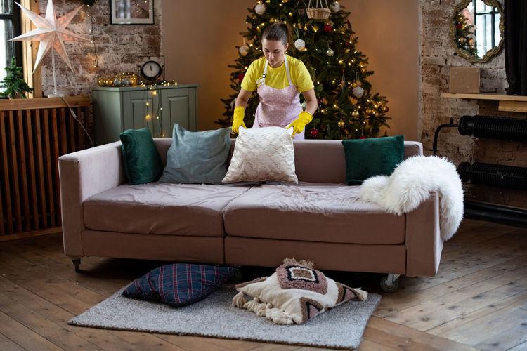 Man sitting on sofa at home