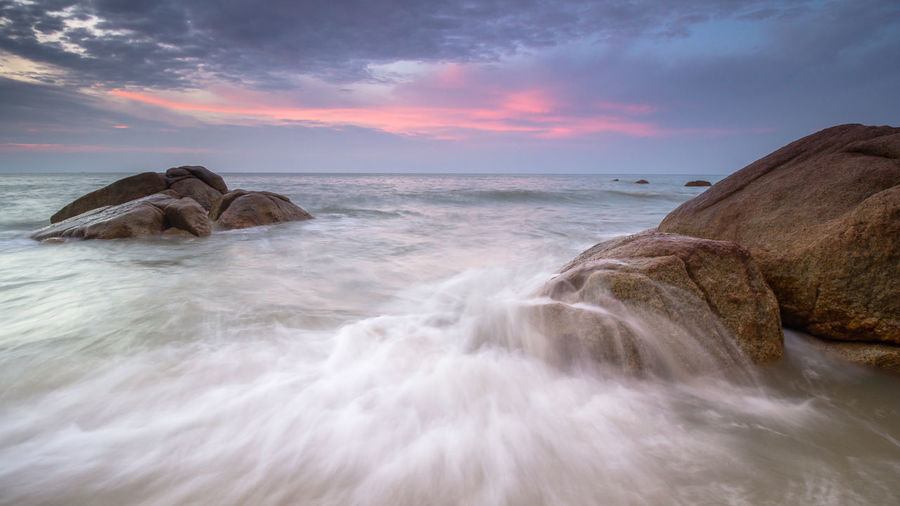 Sunrise at telok Cempedak Beach Beauty In Nature Blurred Motion Cloud - Sky Flowing Water Horizon Horizon Over Water Idyllic Long Exposure Motion Nature No People Outdoors Power In Nature Rock Rock - Object Scenics - Nature Sea Sky Solid Sunset Telok Cemped Water Waterfront