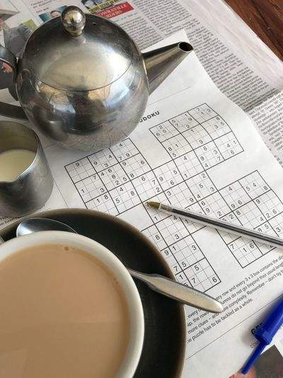Newspaper Relaxation Perfect Saturday Morning Puzzle  Sudoku Teapot Cup Of Tea..  Food And Drink Table Cup Paper Drink Still Life Close-up High Angle View Refreshment No People Pen Hot Drink