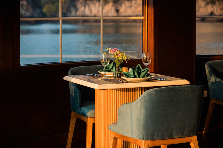 Potted plant on table by window
