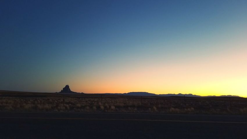 Sunset Clear Sky Landscape Travel Travel Destinations Horizon Ancient Outdoors Beauty Nature Beauty In Nature Lost In The Landscape Photography Colorsofnature Beauty In Nature Dusk Sky Desert Lava Rocks Shiprock New Mexico Dramatic Sky