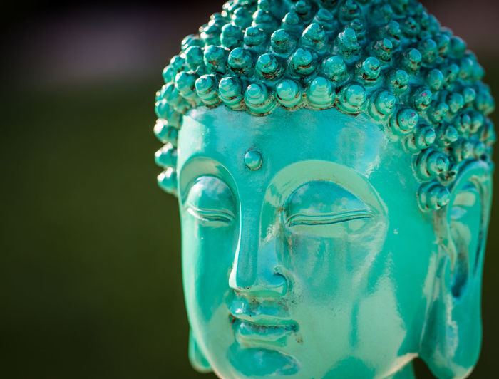 Turquoise Blue Buddha Statue Buddha Buddha Image Art And Craft Blue Buddha Head Buddha Statue Close-up Colored Background Craft Creativity Focus On Foreground Green Color Human Representation Indoors  Male Likeness No People Pattern Purity Representation Sculpture Statue Still Life Studio Shot Turquoise Colored