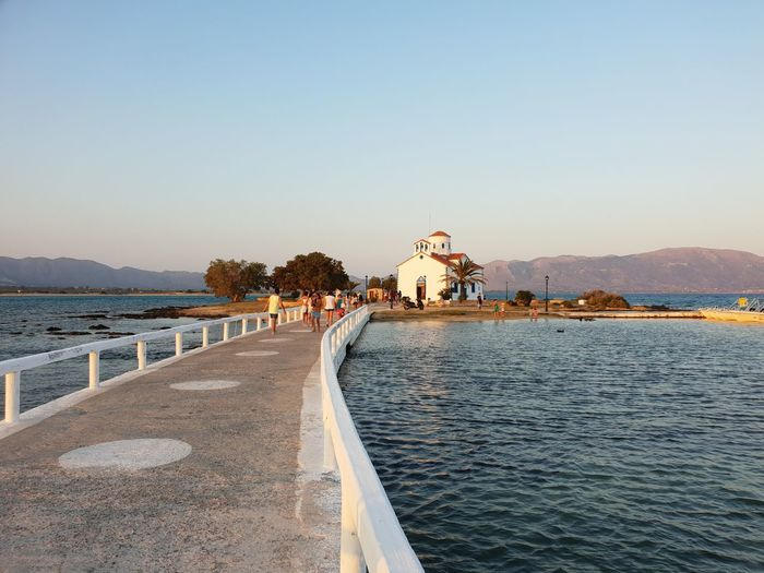 The church of Elafonisos Village Tradition Traditional Waves Mountain Roof Red Pathway Blue White Color Sunset Traditional Mediterranean  Church Peninsula Samsungphotography Sunlight Greece Water Clear Sky Sea Tree Beach Sky Horizon Over Water Seascape Calm Tranquil Scene Scenics