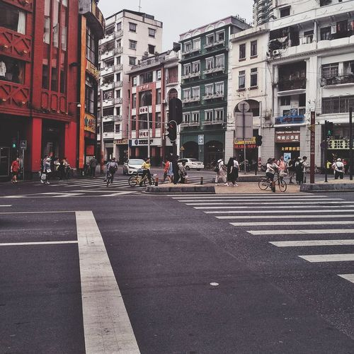Street corner Shot Commercial Street Architecture Canton City City Street Street Cityscape City Life Architecture Building Exterior Road Marking Zebra Crossing Bicycle Lane Crosswalk Pedestrian Crossing Sign Road Signal