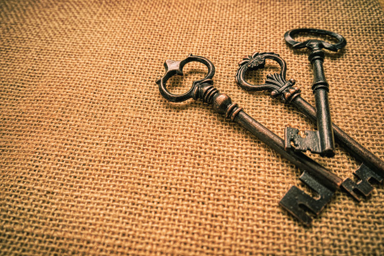 Close-Up Of Keys On Jute