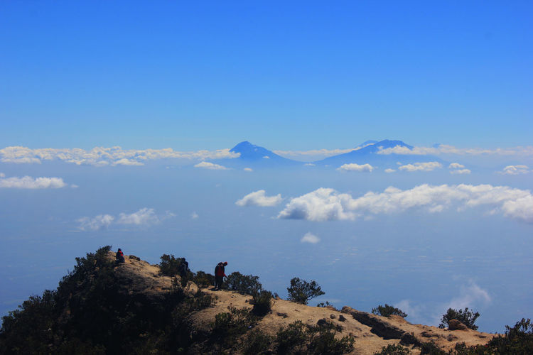 ARJUNA MOUNTAIN Arjuno Mountain Sky Scenics - Nature Beauty In Nature Mountain Cloud - Sky Tranquil Scene Tranquility Nature Blue Day Two People Leisure Activity Real People Environment Non-urban Scene People Hiking Men Lifestyles Landscape Outdoors