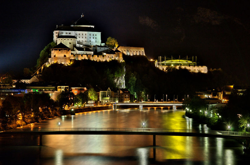 Illuminated kufstein fortress against sky at night