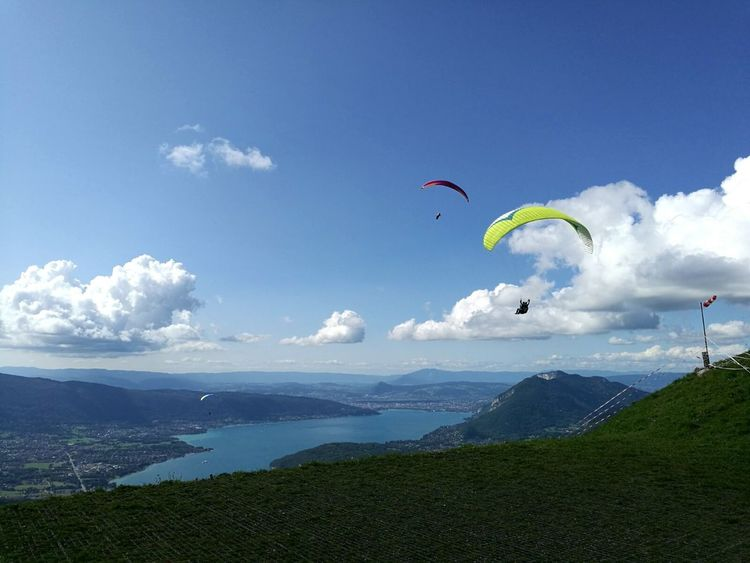 Flying Extreme Sports Sky Sport Mid-air Leisure Activity Paragliding Cloud - Sky Outdoors Vacations Landscape Nature Adventure Aerobatics Annecy Lake France 🇫🇷 Beautiful Mountains And Valleys