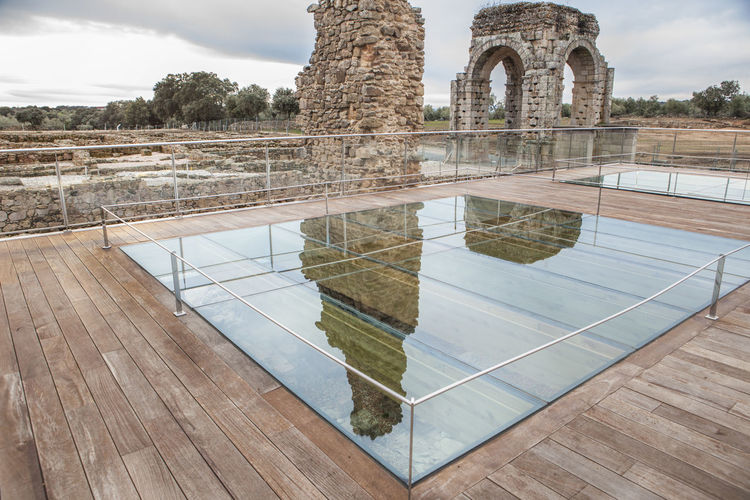 Protective glass floor at Roman site of Caparra, Crossroad ancient city ruins at Silver Route, Via de la Plata, Caceres, Spain Architecture Built Structure Cloud - Sky Day History Nature No People Outdoors Sky Travel Destinations Tree Water
