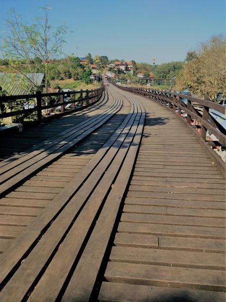 Wood long bridge made by local people in Sangkhla Buri. Lost In The Landscape Beauty In Nature Clear Sky Day High Angle View Nature No People Outdoors Sky Sunlight The Way Forward Transportation Tree