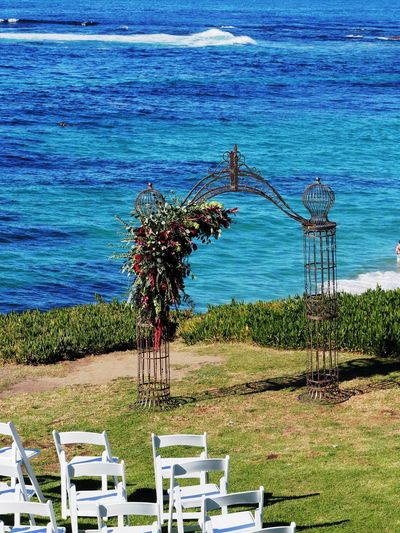 Water Plant Land Nature Seat Sea Chair Day No People Beach Beauty In Nature Grass Sky Growth Field Tranquility Outdoors Tranquil Scene Horizon Over Water Wedding Marriage  Marriage Ceremony Flower Love Togetherness
