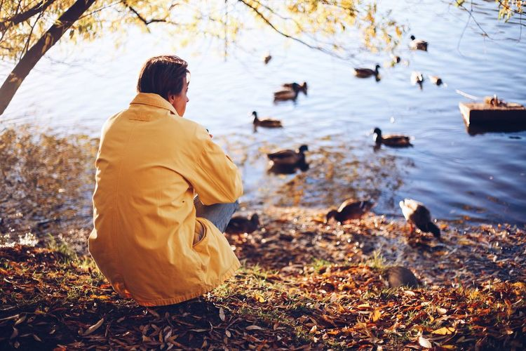 Autumn season Fall_collection Fall Lake Autumn🍁🍁🍁 Autumn colors Autumn Collection Rear View One Person Real People Leisure Activity Nature Lifestyles Water Outdoors Men Sitting Warm Clothing