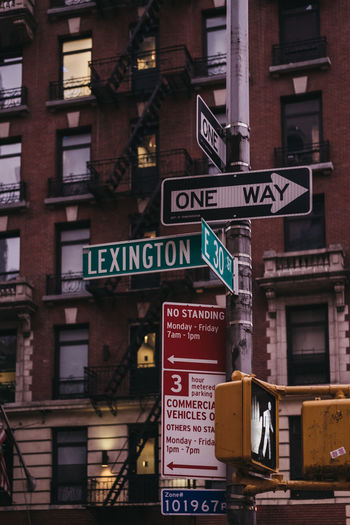 City Life Lexington Avenue Manhattan NYC NYC Street New York New York City One Way USA America Arrow Symbol Building Exterior City Direction Directional Sign Dusk Evening Guidance Low Angle View No People Outdoors Road Road Sign Sign Travel Destinations