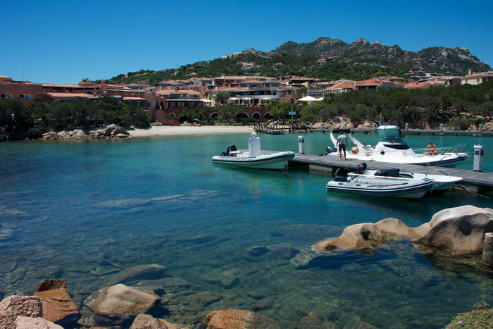 Porto Cervo Porto Cervo, Sardinia Architecture Beauty In Nature Blue Building Exterior Clear Sky Day Moored Mountain Nature Nautical Vessel Outdoors Rafts Rock - Object Scenics Sea Seascape Summer Transportation Travel Destinations Water No People