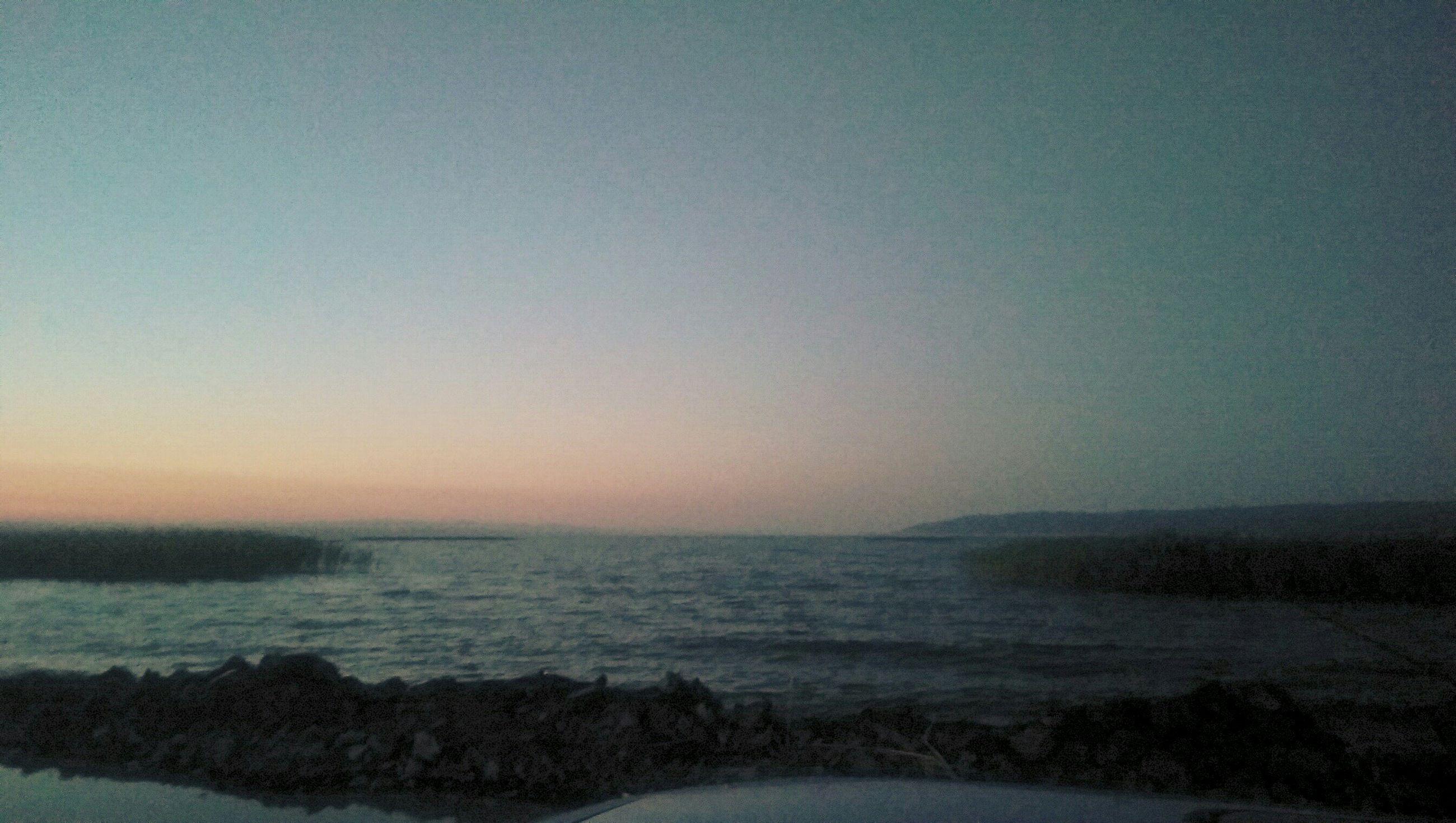 sea, water, tranquil scene, scenics, horizon over water, tranquility, copy space, beauty in nature, clear sky, beach, nature, shore, idyllic, sunset, sky, remote, non-urban scene, calm, dusk, coastline