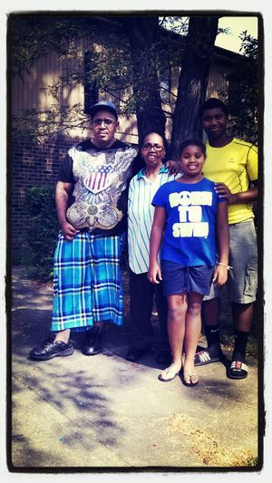 Me and my sis with my grandma and my uncle