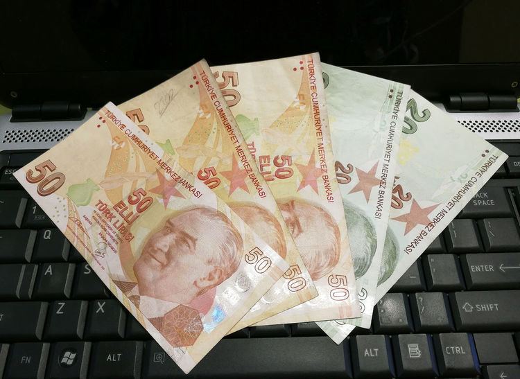 Turkish lira on the laptop #bank Note #colorful #Currency #debt #earnings #green #holiday #money Changer #paying Bills #red #Success #tourism #Turkey #turkish Lir Close-up Communication Currency Finance Indoors  Keyboard No People Paper Currency Savings EyeEmNewHere EyeEm Selects