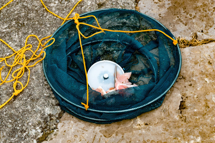 Fishing net with bacon rind in for purpose of crabbing. Conwy harbour, North Wales. Conwy Close-up Crabbing Day Fishing Net High Angle View No People North Wales Outdoors Travel Destinations