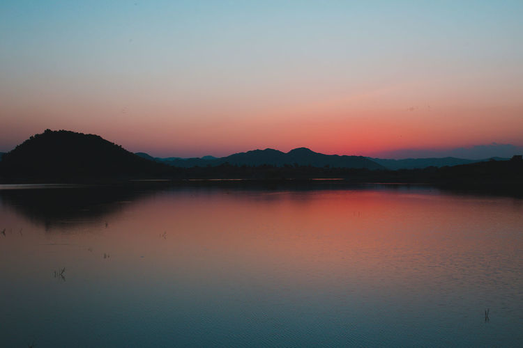 Reflection Sunset Mountain Sky Landscape Lake Water Nature Scenics Outdoors Sun Beauty In Nature Silhouette No People Tranquil Scene Sunlight Tranquility Travel Destinations Summer Nature Reserve Photohunterz Rishikesh Amanvohra Lost In The Landscape