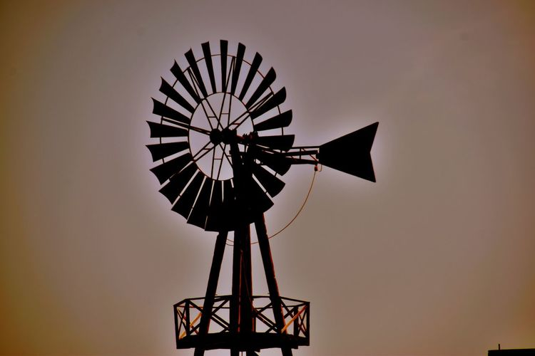 wind Alternative Energy Environment Environmental Conservation Low Angle View No People Outdoors Renewable Energy Silhouette Sky Sunset Technology Traditional Windmill Water Pump Wind Power Wind Turbine