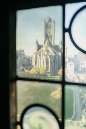 Close-up of city seen through window of building