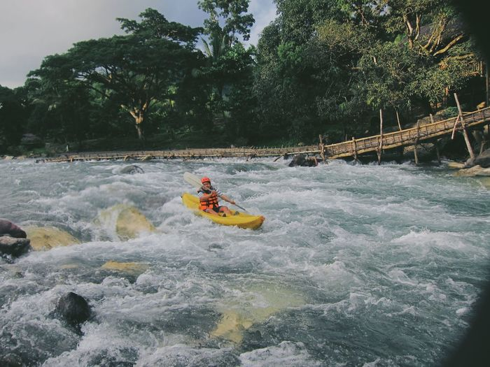 Man kayaking in white water rapids