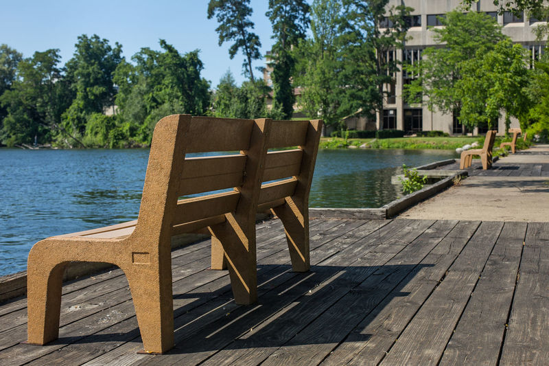 A nice bench on the Boarman River in Traverse City, Michigan. Bench Boardman River Eighth Street Traverse City Fishing Bench Traverse City Traverse City Michigan Architecture Bench View Boardman Chair Day Nature No People Outdoors Sky Tree Water Wood - Material