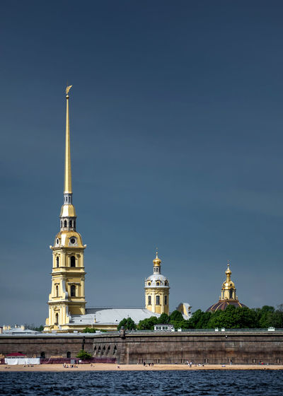 Peter And Paul Cathedral By River Against Blue Sky