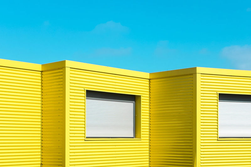 Yellow buildings against clear blue sky