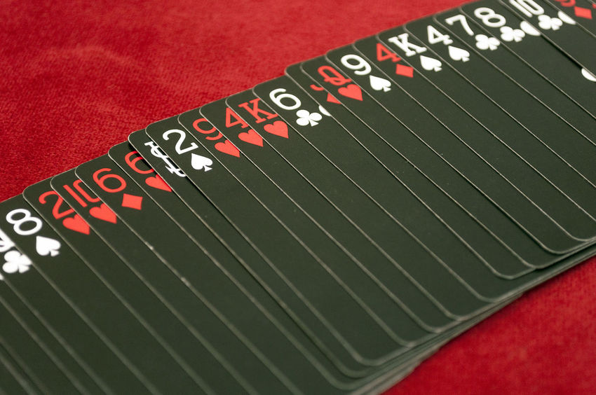 Deck of Black Playing Cards Spread Out On Table Black Cards Close-up Close—up Deck Gambling Game Indoors  Magic No People Playing Cards Poker, Card, Royalflush Red Shuffle Suite Table Trick