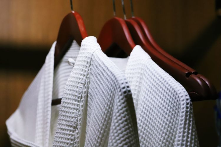 Close-up of clothes hanging at store