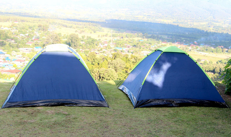 Camping and Tent on Mountain in Thailand with beautiful Landscapes during winter. Mountain Landscape Green Grass Thailand Thai Travel View Health Tree Healthcare Abundance Abundant Lifestyle Lifestyle People Holiday Recreation  Relax Sky Background Natrue Sky Clouds Tent Summer Camping Protection Sky Grass Triangle Shape Sheltering Sun Lounger Beach Umbrella