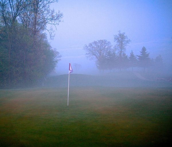 Lost In The Landscape Outdoors Fog Tranquility No People Day Green Grass Nature Sky Trees Golf Course Flag Putting Green
