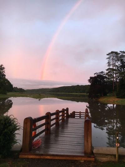 Beauty In Nature Rainbow Nature Tranquility Tranquil Scene Water Sky Day Jetty late evening at slebech