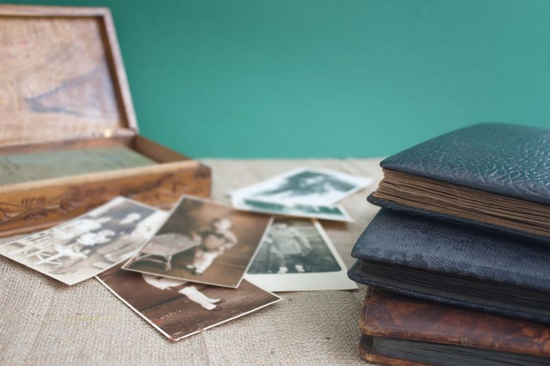 Old Documents Wooden Box Black Album Memories Black And White Vintage Photos Studio Shot Room Home Interior Home Table No People Indoors  Still Life Close-up Focus On Foreground Paper Selective Focus Green Color The Past