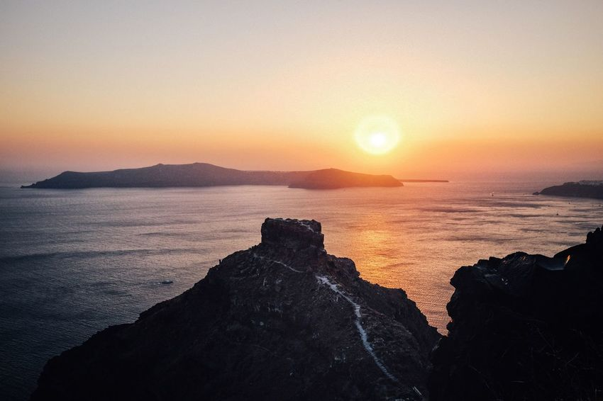 Sunset Sea Nature Scenics Beauty In Nature Sun Silhouette Tranquil Scene Tranquility Sky Horizon Over Water Water No People Rock - Object Outdoors Sunlight Clear Sky Mountain Cliff Greece