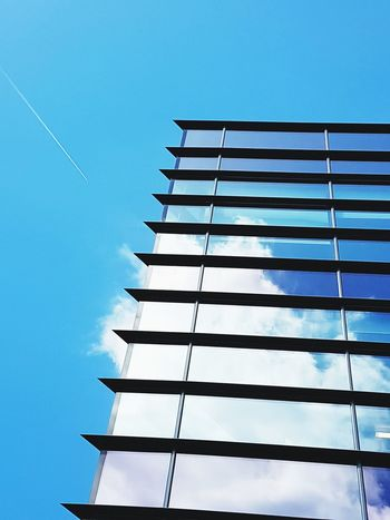 Cloudscape Low Angle View Blue Sky No People Outdoors Architecture Day Abstract Cloudporn Reflections In The Glass Windows Hues Of Blues Airplane Trails Aeroplane In The Sky Angles And Views The Architect - 2017 EyeEm Awards
