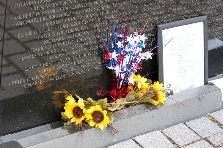 For those fallen, but not forgotten. Thousands of similar items are left each year at the Vietnam Veteran's Memorial. The Cost Of Freedom Honoring The Dead Rememberance Flower High Angle View Day No People Yellow Outdoors Close-up