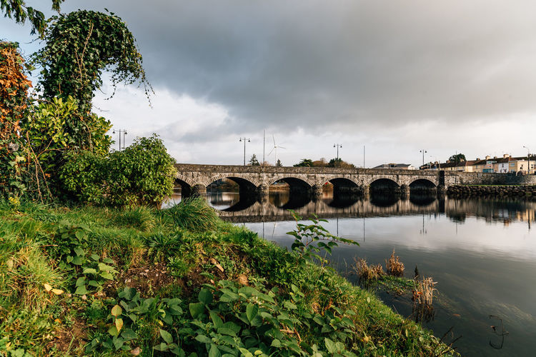 Scenic view of river at sunrise and reflections in the wild atlantic way of Ireland Ireland Travel Wild Atlantic Way Arch Arch Bridge Architecture Bridge Bridge - Man Made Structure Built Structure Cloud - Sky Connection Day Growth Irish Kerry Killorglin Nature No People Outdoors Plant Reflection River Scenery Sky Transportation Tree Water