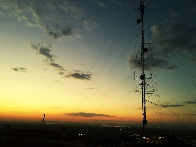 Sunset Sky Cable Silhouette Cloud - Sky Nature No People Beauty In Nature Scenics - Nature Electricity  Technology Orange Color Connection Electricity Pylon Outdoors Power Line  Tranquility Tranquil Scene City Dusk