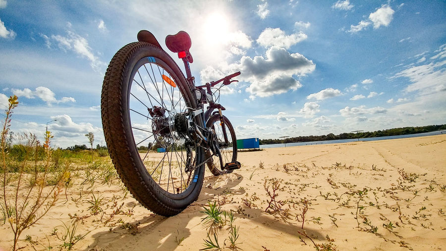 Wheel Beach Bicycle Bycicle Cloud - Sky Clouds Clouds And Sky Coast Day Easterneurope Land Vehicle Mode Of Transport Nature No People Outdoors River Sand Sky Sport Tire Training Transportation Velobike Water Wheels